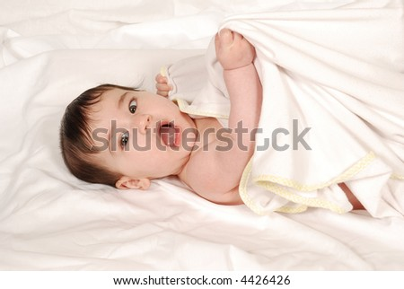 cute baby girl wrapped in bath towel - stock photo
