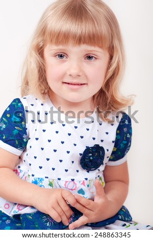 Cute baby girl 3-4 year old posing over white. Childhood.  - stock photo