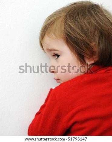 Cute baby hiding - stock photo