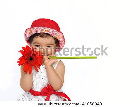 Cute baby holding a flower - stock photo