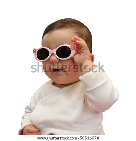 Cute baby holding her sunglasses - stock photo
