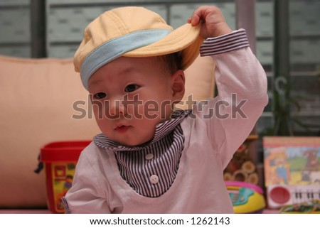 Cute baby holding his hat