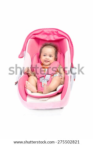 Cute baby in a car seat, isolated on white - stock photo