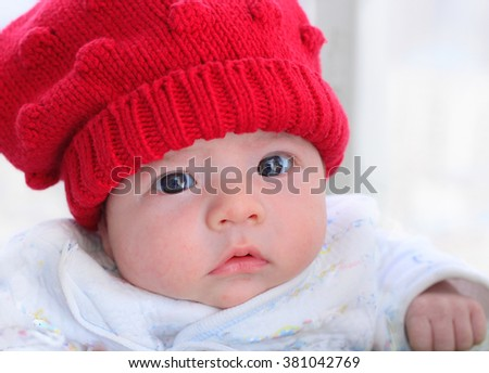 Cute Baby in a Red Wooll Hat - stock photo