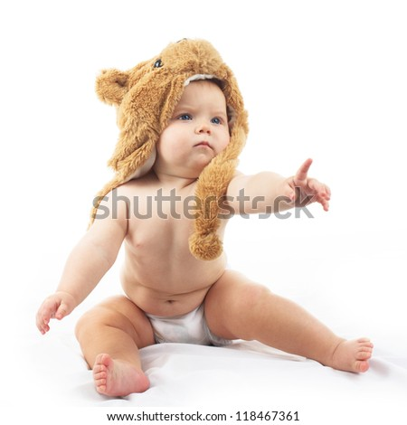 cute baby in bear cap in white background - stock photo