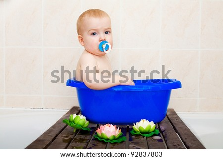 cute baby in the bath - stock photo