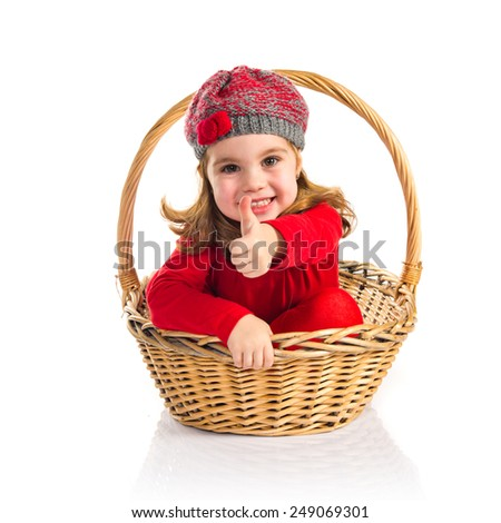 Cute baby inside basket with thumb up  - stock photo