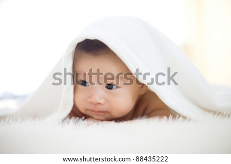 cute baby lie on bed - stock photo