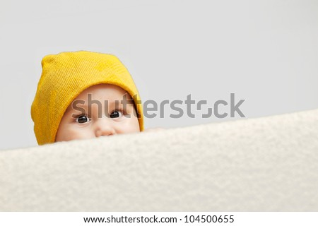 Cute Baby looking behind a sofa - stock photo