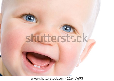 Cute baby looking into camera and laughing, showing two teeth - stock photo