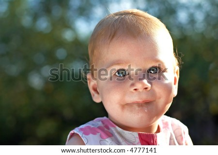 cute baby looking to the camera - stock photo