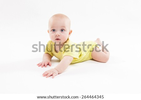 cute baby lying on the background and smiling. Photo with depth of field
