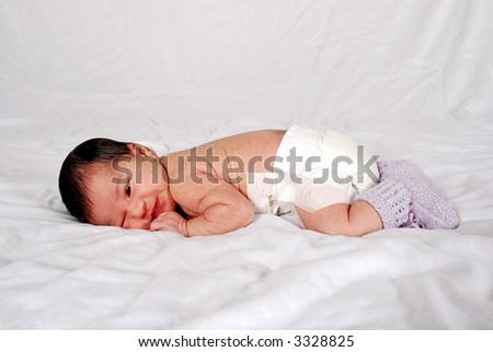 cute baby lying on tummy - stock photo