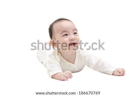 Cute baby lying on white floor