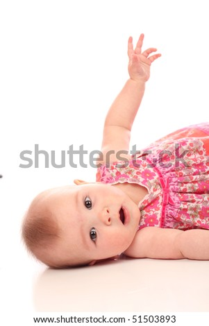 Cute Baby, 6 months old lying on her side - stock photo