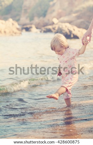 Cute Baby on the Beach. Little Child Girl