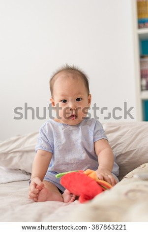 Cute baby on the bed