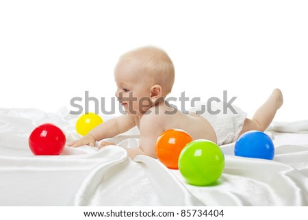 Cute baby play in bed with color balls