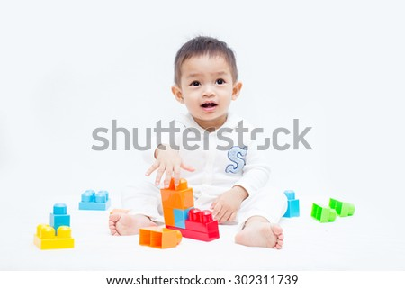 cute baby play with toys - stock photo