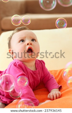 Cute Baby Playing with Bubbles - stock photo