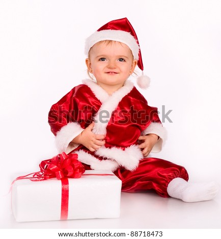 cute baby playing with gifts