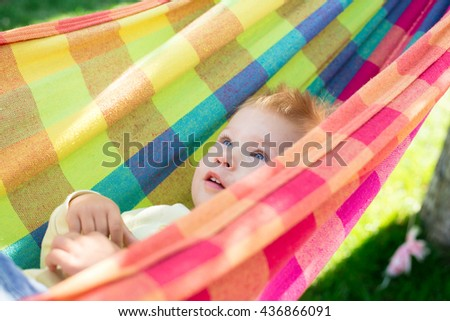 cute baby resting on a colorful hammock beautiful cheerful little boy resting in a hammock and cute baby resting on colorful hammock stock photo 436866091      rh   shutterstock
