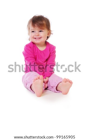 cute baby sitting and smiling. pink clothing. isolated on white