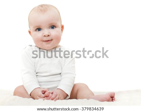 Cute baby sitting on a blanket and looking at camera.Bright closeup portrait of adorable baby. - stock photo