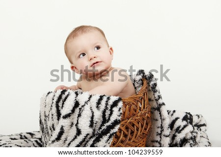 Cute baby sitting on blanket - stock photo