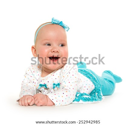 Cute baby six-month-old girl with polka dotted shirt and light blue pants on white background - stock photo