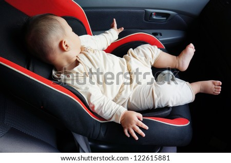 cute baby sleep in the baby car seat at the front car seat - stock photo