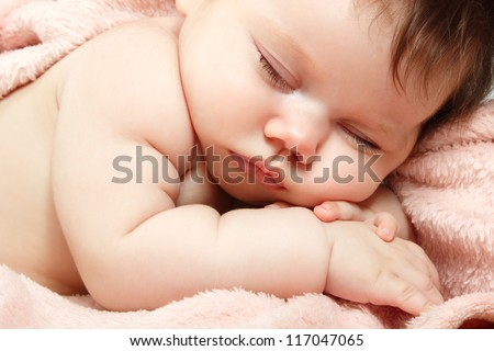 cute baby sleeping, beautiful kid's face closeup, studio shot - stock photo