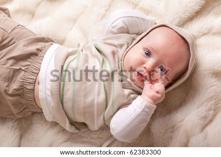 cute baby sucking fingers(4 months) - stock photo