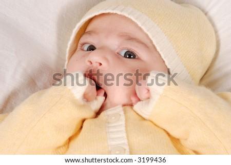 cute baby sucking hand - stock photo