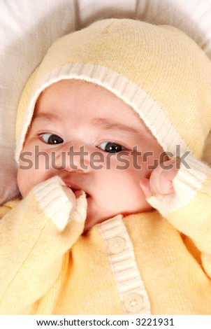 cute baby sucking hand - stock photo