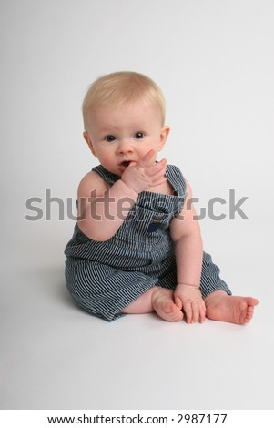 cute baby teething - stock photo