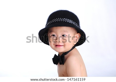Cute baby upright and smile - stock photo
