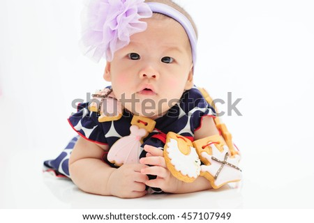 cute baby wear cookies isolated on the white background