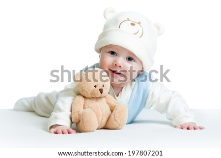cute baby weared funny hat with plush toy - stock photo