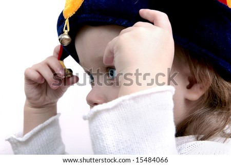 Cute baby wearing funny clown hat - stock photo
