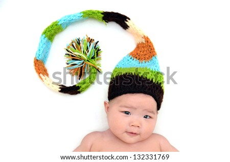 Cute baby with a knitted colorful hat - stock photo