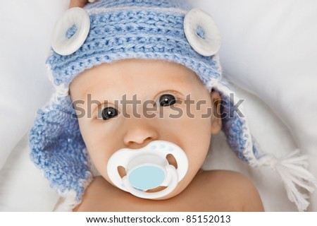 Cute baby with a pacifier. - stock photo