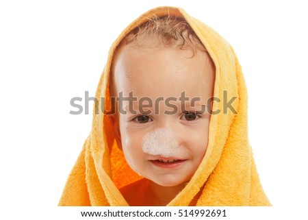 Cute baby with a yellow towel. Children hygiene