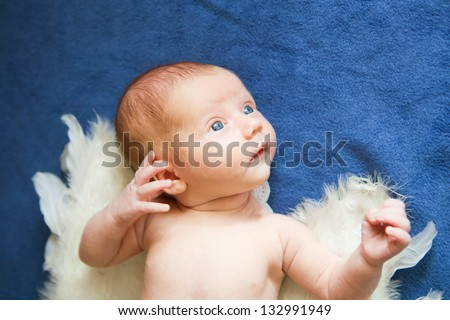 Cute baby with angel wings - stock photo