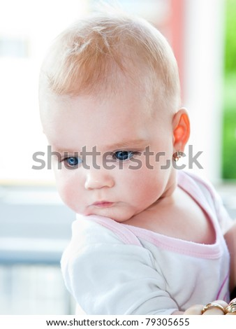 Cute baby with blue eyes - stock photo