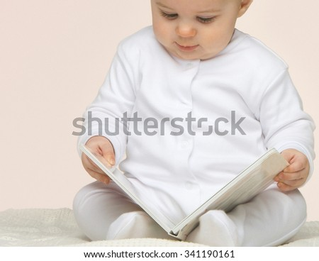 Cute baby with book  - stock photo