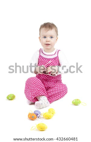 cute baby with Easter eggs - stock photo