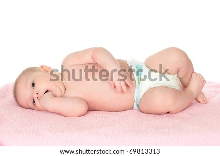 Cute baby with fingers in mouth lying on a blanket. Isolated over white background - stock photo
