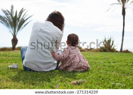cute baby with her mother - stock photo