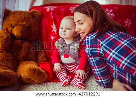 Cute baby with mother